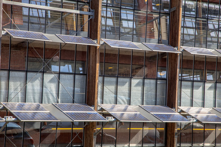 Alternative way of using solar panels on the Front of an Office Building as a Solution for Global Warming