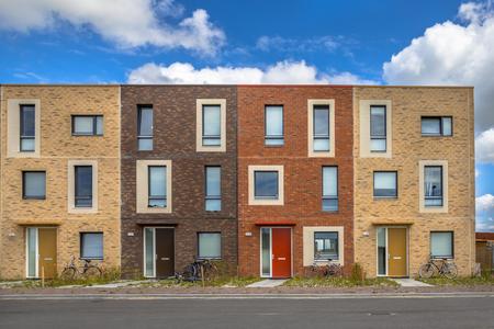 Foto de Four Modern Social housing in terra colors containing modest family apartment houses in Ypenburg, The Hague, Netherlands - Imagen libre de derechos