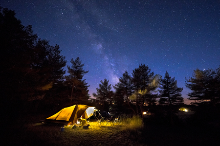Photo pour Family tent with rigid steel poles on camping ground under Starry sky with Milky Way - image libre de droit