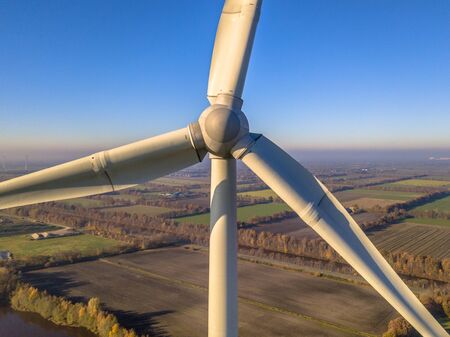 Photo pour Close up aerial view of Rotor and Nacelle of Wind Turbine in german countryside on a sunny day - image libre de droit
