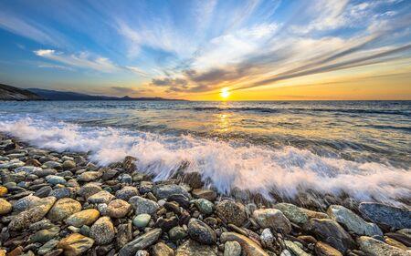 Photo pour Waves of the Mediterranean sea breaking on pebble beach near Farinole Cap Corse, Corsica, France - image libre de droit