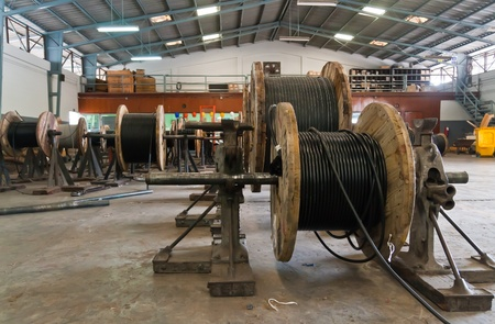 Wooden electric cable reels in stockpile for distribution