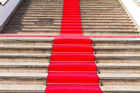 Red carpet way on staircase for important person