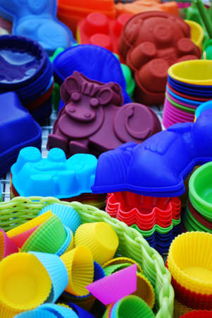 Colorful and differently shaped silicone baking pans as a background