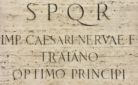 The Emperor Trajan's monument pedestal in the Imperial forum with latin inscription: S.P.Q.R, Emperor Caesar Nerva Trajan, the best ruler