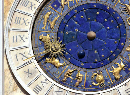 Photo for Ancient time and Astrology. A detail from Saint Mark's Clocktower in the center of Venice with zodiac signs and roman numbers - Royalty Free Image