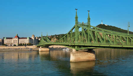 Budapest, Hungary, September 15, 2016: The famous Gellert Baths with Liberty Bridge across Danube, early in the morning