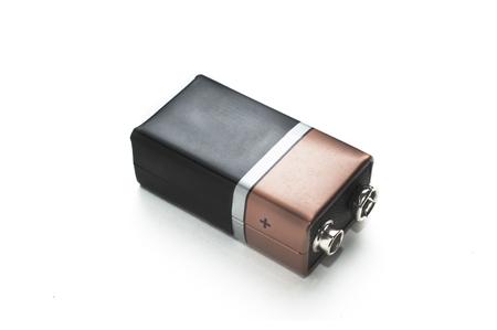 Photo pour A blank black and copper 9v battery on white background - image libre de droit