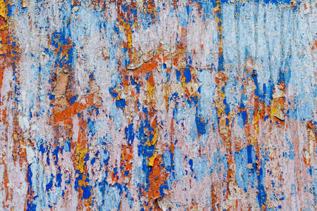 Photo pour Minimalist colourful textured background of old and rusted whit, blue, brown and orange  paing on metallic surface, in direct sun light in an urban environment - image libre de droit