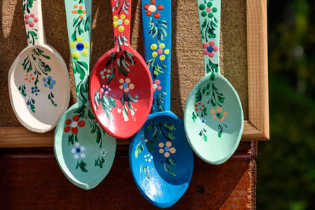 Photo pour Many hand made painted wooden spoons with traditional decorations displayed for sale as souvenirs at a street market fair in Bucharest, Romania - image libre de droit
