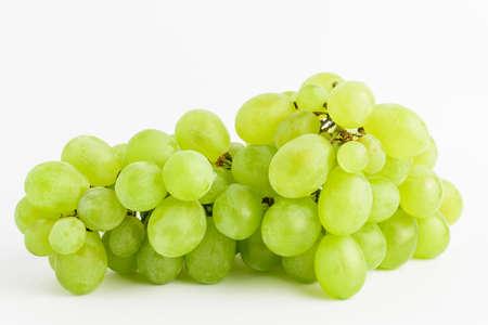 Foto für One bunch of ripe organic white grapes isolated on white background, side view - Lizenzfreies Bild