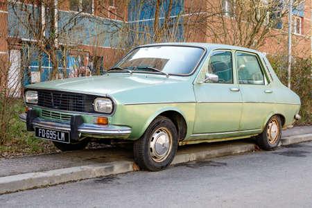 Foto für Bucharest, Romania, 3 March 2021 Old retro vivid green Romanian Dacia 1300 classic car parked in a street in a sunny spring day - Lizenzfreies Bild