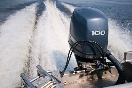 Outboard motor marked by a fiery wake
