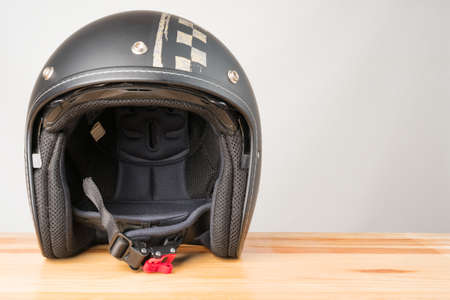 Photo for Motorcycle protective gear - open face helmet on a wooden background. Copy space on the right. - Royalty Free Image