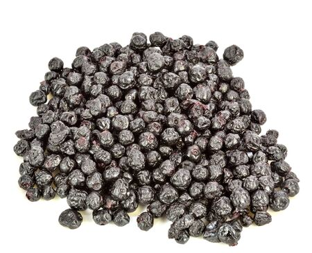 A pile of dried blueberries on a white background.
