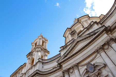 Sunny view of Piazza Navona with the blue sky and clouds in Rome, Italy