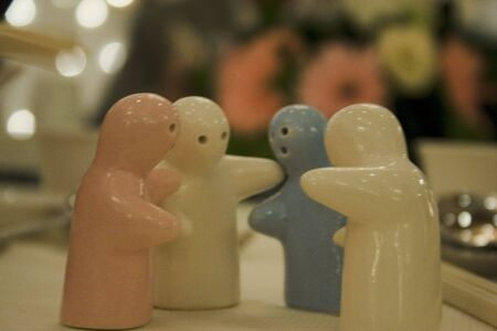 Figurines discussing on a dinner table