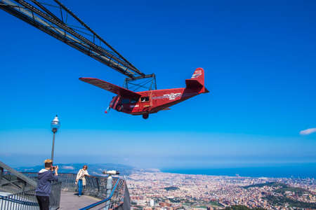 Barcelona, Spain - April 6, 2016: Airplane carousel in Tibidabo Amusement Park, Tibidabo, Barcelona, Spain. The Tibidabo theme park, Barcelona, Spain.