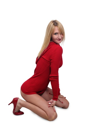 A hot blonde kneels, isolated on a white background with generous copyspace