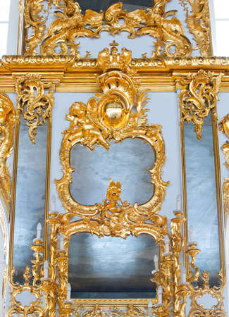 mirrors in frames with golden decorations on wall