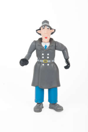 Adelaide, Australia - June 8, 2015: A photo of an Inspector Gadget Figruine, isolated on a white background. Inspector Gadget is an animated television series based on the adventures of a clumsy cyborg policeman. The series was syndicated around the world