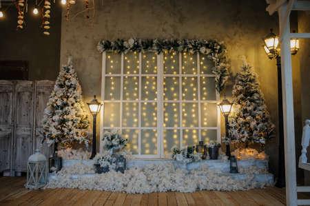 Photo pour Photography studio with christmass decorations and vintage streetlamps - image libre de droit