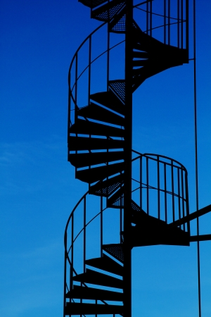 Spiral staircase silhouette.