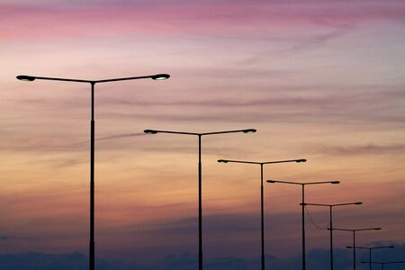 Streetlights at sunset.