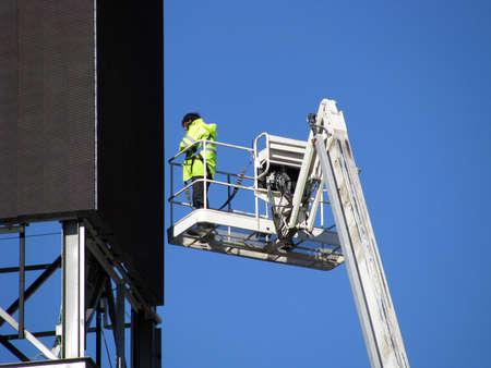 Men in Platform Crane repairing breakdown