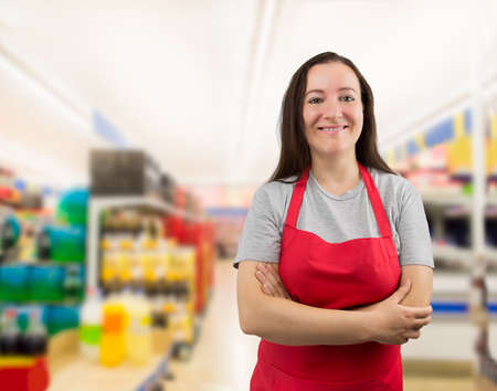 Photo for portrait of a saleswoman with crossed arms at the supermarket - Royalty Free Image