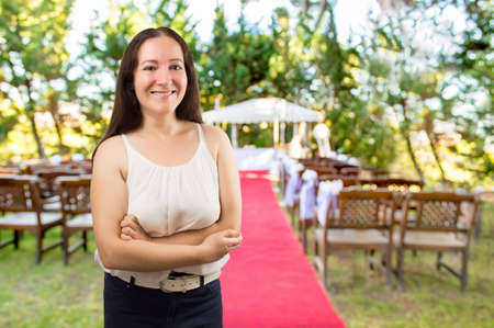Photo pour wedding planner woman  is organizing  the wedding reception venue for her customers standing and smiling at the wedding place - image libre de droit