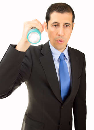 businessman looking for something with a flashlight on white background