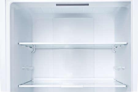 Photo pour Empty open fridge with shelves, refrigerator.Copy space. - image libre de droit
