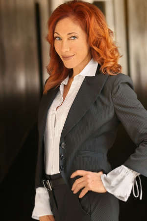 Portrait of a red-headed attractive businesswoman smiling