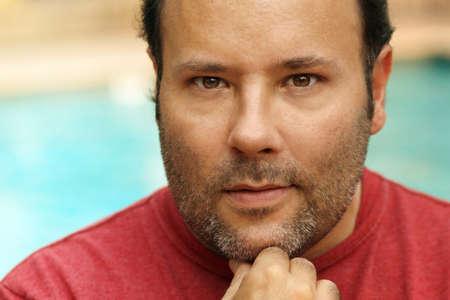 Foto de Close-up headshot portrait of a natural looking man thinking with eye contact - Imagen libre de derechos