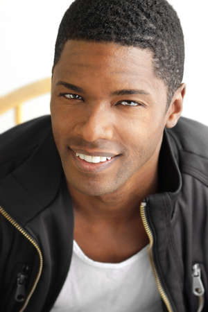 Happy portrait of a hip cool young black man with big smile