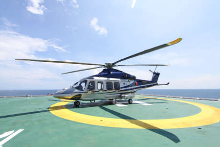helicopter parking landing on offshore platform. Helicopter transfer crews or passenger to work in offshore oil and gas industry.