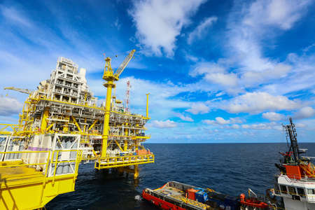 Offshore construction platform for production oil and gas, Oil and gas industry and hard work, Production platform and operation process by manual and auto function, oil and rig industry and operation.