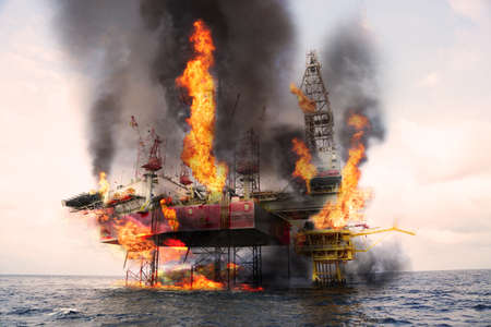 Photo for Offshore oil and rig construction damaged because worst case or fire case which can't control situation. Oil spill into the sea because incorrect of operation and accident in job out of safety rule. - Royalty Free Image