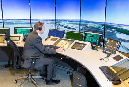 Sofia, Bulgaria - December 2, 2014: Air Traffic Controller at the Bulgarian Air Traffic Services Authority (BULATSA) control center are operating on their work places.