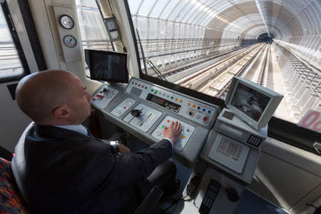 Sofia, Bulgaria - April 2, 2015: A subway train operator is driving the train for its first ride from the Sofia Airport extension.
