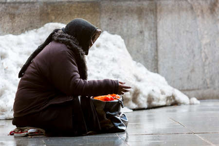 Photo for Anonymous woman is begging in the street of Sofia. Bulgaria is the poorest country in the European Union. - Royalty Free Image