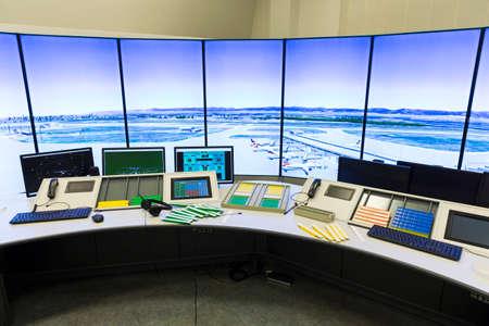 Photo pour Bullgaria's Air Traffic Services Authority control center room. Controller's desk near control computer monitors. No people. - image libre de droit
