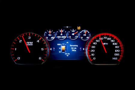 Foto de Modern light car mileage (dashboard, milage) isolated on a black background. New display of a modern car. Oil life. - Imagen libre de derechos