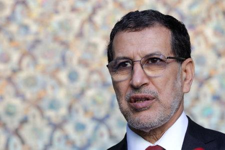 Foto de Rabat, Morocco - 30 November 2018: Prime Minister of Morocco Saadeddine Othmani speaks to the media during a press conference in Dar al-Makhzen - Royal Palace of Rabat. - Imagen libre de derechos