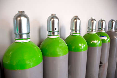 Photo pour Seamless Steel Industrial Gas Cylinders. Pressurized Cylinder. Industrial stainless steel bottles in line. - image libre de droit