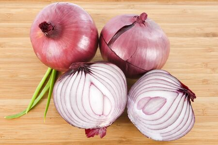 red onion on a wood cutting board