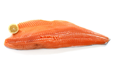 large salmon fillet in front of white background