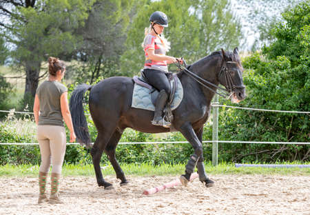 Photo pour riding girl are training her horse in equestrian center - image libre de droit