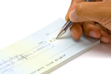 A hand signing a Cheque